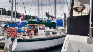 Mast and rigging inspection at Canoe Cove Marina. Vancouver Photo Ray Penson
