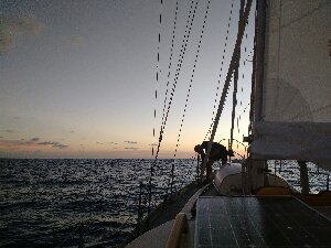 Rigging Spinnaker pole at sunset
