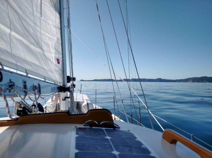 Approaching Cape Jackson on glassy seas. Photo Ray Penson