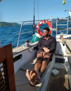 Steven working hard sailing, Micky (wind vane) is steering Photo Ray Penson