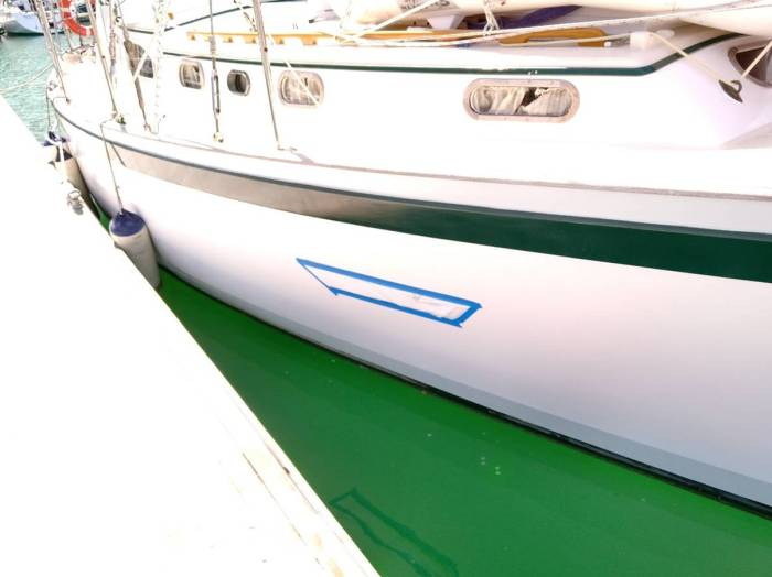 Waterproof cover over damage to hull
