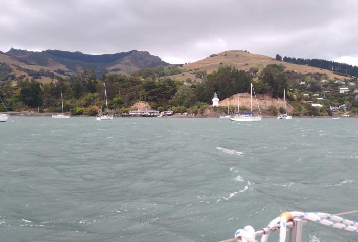 Akaroa Yacht Club and Old Lighthouse. Photo Ray Penson